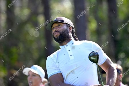 Larry Fitzgerald watches his tee shot on the second hole during the final round of the Tournament of Champions LPGA golf tournament, in Lake Buena Vista, Fla