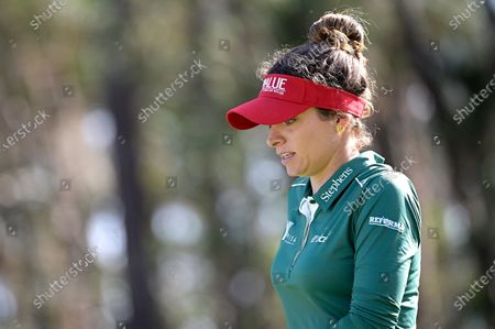 Gaby Lopez, of Mexico, walks on the second hole after hitting her tee shot during the final round of the Tournament of Champions LPGA golf tournament, in Lake Buena Vista, Fla