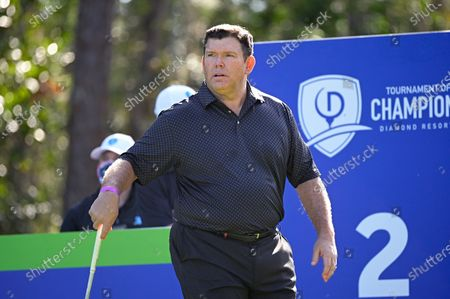 Bret Baier sets up for his tee shot on the second hole during the final round of the Tournament of Champions LPGA golf tournament, in Lake Buena Vista, Fla