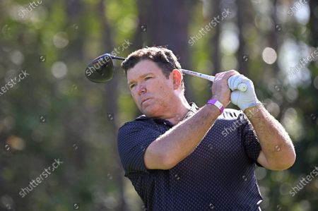 Bret Baier watches his tee shot on the second hole during the final round of the Tournament of Champions LPGA golf tournament, in Lake Buena Vista, Fla