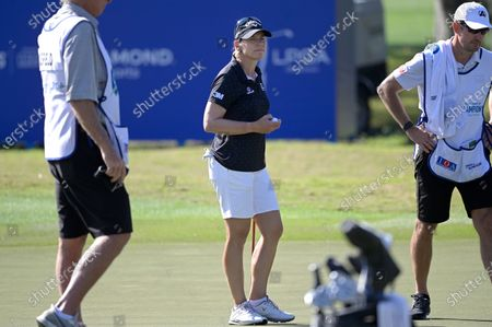 Annika Sorenstam, center, of Sweden, waits to putt on the first green with her caddie Mike McGee, right, during the final round of the Tournament of Champions LPGA golf tournament, in Lake Buena Vista, Fla