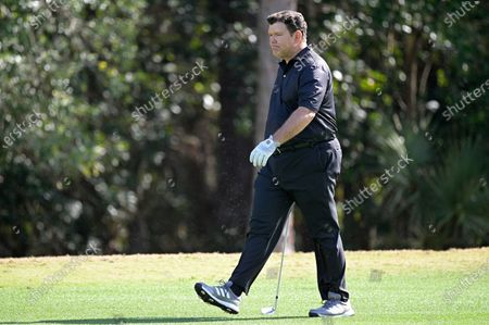 Bret Baier walks on the eighth fairway during the final round of the Tournament of Champions LPGA golf tournament, in Lake Buena Vista, Fla