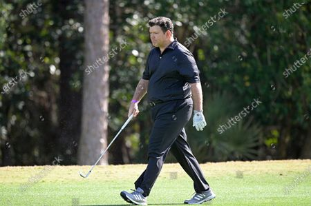 Stock Image of Bret Baier walks on the eighth fairway during the final round of the Tournament of Champions LPGA golf tournament, in Lake Buena Vista, Fla