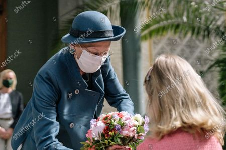 Queen Margrethe II of Denmark (L) arrives at Glyptoteket to open an exhibition featuring the works of Auguste Rodin, in Copenhagen, Denmark, 21 April 2021. Museums, restaurants and bars reopen on 21 April as Denmark is gradually opening up from the coronavirus pandemic-related lockdown.