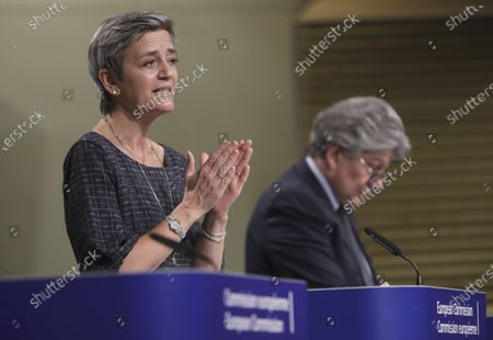 European Commissioner for Europe fit for the Digital Age Margrethe Vestager, left, and European Commissioner in charge of internal market Thierry Breton participate in a media conference on an EU approach to artificial intelligence, following a weekly meeting of EU Commissioners, at EU headquarters in Brussels