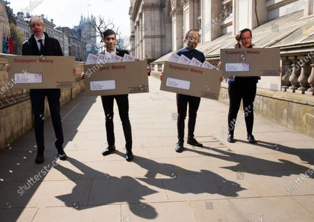 Labour supporters stage a protest at the gates of Downing Street. They are unhappy at the allegations of overspending and sleaze. They are wearing masks showing Boris Johnson, Rishi Sunak, Matt Hancock and David Cameron which alludes to the Greensill Capital story.