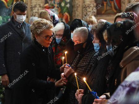 Batkivshchyna leader, MP Yulia Tymoshenko (L) attends the funeral service of Ukrainian writer and politician Volodymyr Yavorivskyi at the Saint Michael's Vydubychi Monastery, Kyiv, capital of Ukraine.