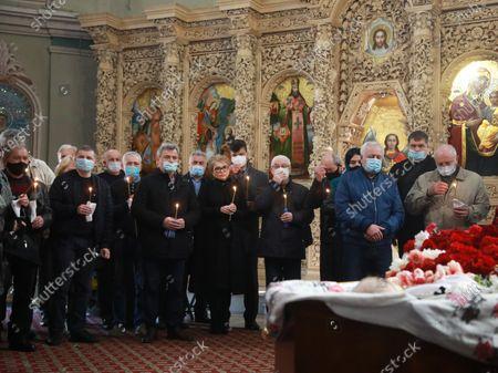 Batkivshchyna leader, MP Yulia Tymoshenko (C) attends the funeral service of Ukrainian writer and politician Volodymyr Yavorivskyi at the Saint Michael's Vydubychi Monastery, Kyiv, capital of Ukraine.