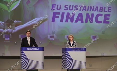 Valdis Dombrovskis (L), European Commission Executive Vice-President in charge of an Economy that works for People, and EU commissioner in charge of Financial services, Financial stability and the Capital Markets Union, Mairead McGuinness (R), give a press conference on the Sustainable Finance Package following a weekly meeting of the EU Commission in Brussels, Belgium, 21 April 2021.