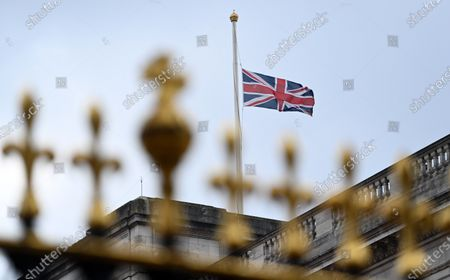 Stock Image of The Union flag flies at half mast outside Buckingham Palace in London, Britain, 21 April 2021. The Queen is marking her 95th birthday while still in official mourning for her late husband Prince Philip. For the second year running the royal gun salutes, which usually mark the Queen's birthday have been cancelled due to the Covid-19 pandemic.