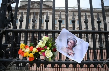 Stock Photo of Tributes to Britain's Queen Elizabeth II outside Buckingham Palace in London, Britain, 21 April 2021. The Queen is marking her 95th birthday while still in official mourning for her late husband Prince Philip. For the second year running the royal gun salutes, which usually mark the Queen's birthday have been cancelled due to the Covid-19 pandemic.