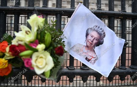 Stock Picture of Tributes to Britain's Queen Elizabeth II outside Buckingham Palace in London, Britain, 21 April 2021. The Queen is marking her 95th birthday while still in official mourning for her late husband Prince Philip. For the second year running the royal gun salutes, which usually mark the Queen's birthday have been cancelled due to the Covid-19 pandemic.