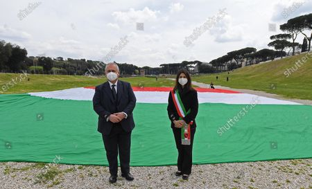 Mayor of Rome, Virginia Raggi (R), and SS Lazio president Claudio Lotito (L) in the Circo Massimo, the ancient Roman chariot-racing stadium and mass entertainment venue, in Rome, Italy, 21 April 2021, during the celebrations on the occasion of the foundation of the city (Natale di Roma).