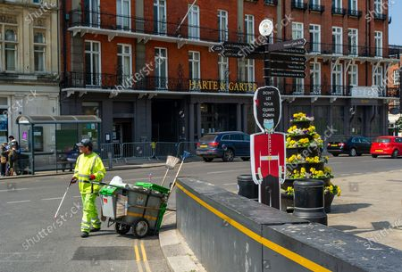 A street cleaner at work outside Windsor Castle. Queen Elizabeth II is spending her 95th Birthday at Windsor Castle today following the sad passing of her husband HRH Prince Philip, the Duke of Edinburgh. The ceremonial Royal Standard was flying on Windsor Castle, however, the town was very quiet this morning