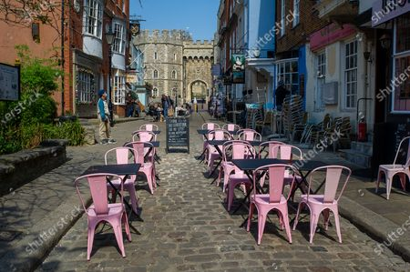 Quiet cobbled streets opposite Windsor Castle. Queen Elizabeth II is spending her 95th Birthday at Windsor Castle today following the sad passing of her husband HRH Prince Philip, the Duke of Edinburgh. The ceremonial Royal Standard was flying on Windsor Castle, however, the town was very quiet this morning