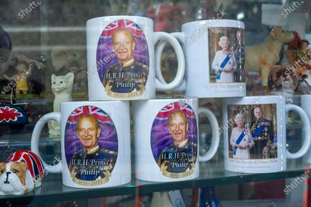 Prince Philip memorial mugs are for sale already in tourist shops in Windsor. Queen Elizabeth II is spending her 95th Birthday at Windsor Castle today following the sad passing of her husband HRH Prince Philip, the Duke of Edinburgh. The ceremonial Royal Standard was flying on Windsor Castle, however, the town was very quiet this morning
