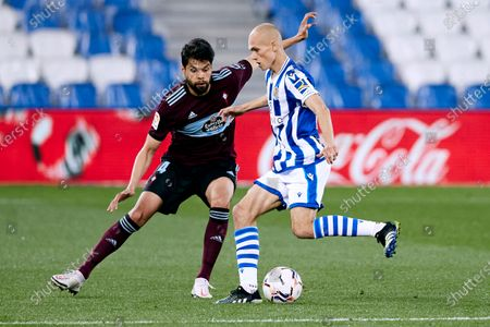 Jeison Murillo of RC Celta competes for the ball with Jon Guridi of Real Sociedad CF during the La Liga match between Real Sociedad CF and RC Celta at Reale Arena on April 22, 2021 in San Sebastian, Spain.