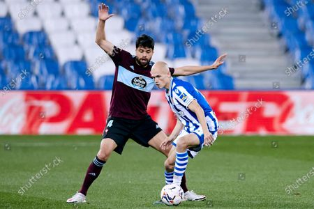 Stock Picture of Jeison Murillo of RC Celta competes for the ball with Jon Guridi of Real Sociedad CF during the La Liga match between Real Sociedad CF and RC Celta at Reale Arena on April 22, 2021 in San Sebastian, Spain.
