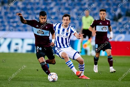 Jeison Murillo of RC Celta competes for the ball with Mikel Oyarzabal of Real Sociedad CF during the La Liga match between Real Sociedad CF and RC Celta at Reale Arena on April 22, 2021 in San Sebastian, Spain.