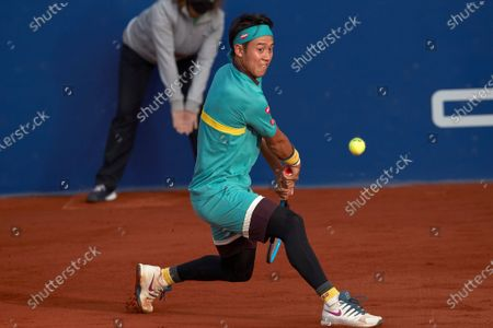 Japanese tennis player Keith Nishikori in action against Chilean Christian Garin during the Barcelona Open Banc Sabadell - Conde de Godo tournament round of 32 match in Barcelona, Spain, 21 April 2021.
