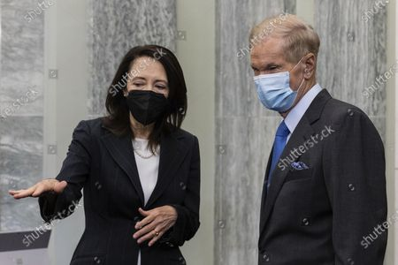 Former Sen. Bill Nelson, nominee to be administrator of NASA, speaks with Senate Commerce, Science, and Transportation Committee Chairman Maria Cantwell, D-Wash., prior to the start of a Senate Committee on Commerce, Science, and Transportation confirmation hearing, on Capitol Hill in Washington