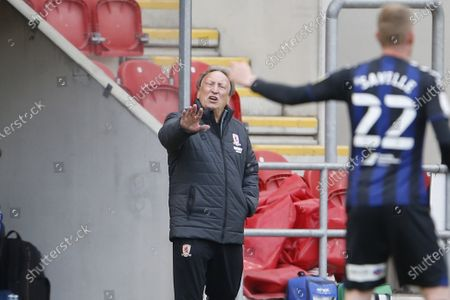 Middlesbrough manager Neil Warnock talking to Middlesbrough midfielder George Saville  during the EFL Sky Bet Championship match between Rotherham United and Middlesbrough at the AESSEAL New York Stadium, Rotherham