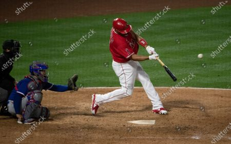 Los Angeles Angels first baseman Albert Pujols (5) smacks a solo home run against Texas Rangers relief pitcher Taylor Hearn (52) in the 7th inning at Angel Stadium on April 20, 2021 in Santa Ana California.(Gina Ferazzi / Los Angeles Times)