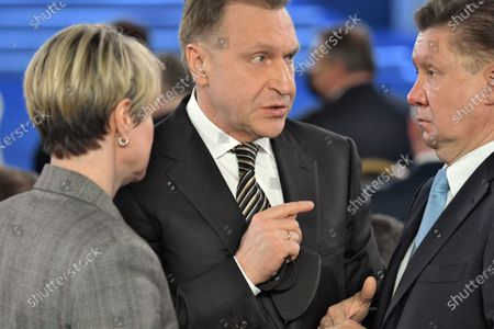 Stock Photo of Annual Address of Russian President Vladimir Putin to the Federal Assembly at the Manezh Central Exhibition Hall. Igor Shuvalov, chairman of the state corporation Bank for Development and Foreign Economic Affairs (Vnesheconombank) (center) and Alexey Miller, chairman of the board of Gazprom, before the annual address