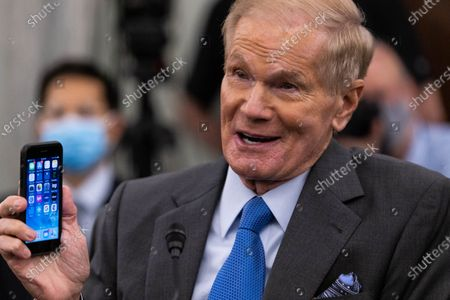 NASA Administrator nominee former US Senator Bill Nelson (Democrat of Florida), testifies while holding his cell phone, during a Senate Commerce, Science, and Transportation Committee nomination hearing on Capitol Hill, in Washington,