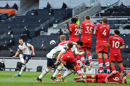 Tottenham's Eric Dier, left, takes a free kick during an English Premier League soccer match between Tottenham Hotspur and Southampton at the Tottenham Hotspur Stadium in London, England