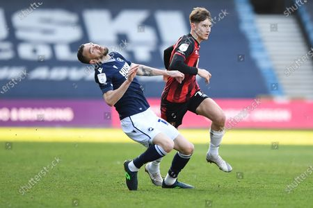 Millwall defender Scott Malone(14)  and AFC Bournemouth midfielder David Brooks (7) during the EFL Sky Bet Championship match between Millwall and Bournemouth at The Den, London