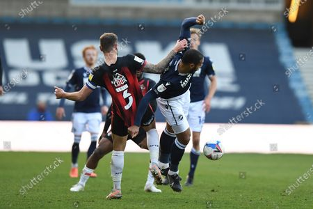 AFC Bournemouth defender Steve Cook (3) and Millwall forward Kenneth Zohore(13)  battles for possession during the EFL Sky Bet Championship match between Millwall and Bournemouth at The Den, London