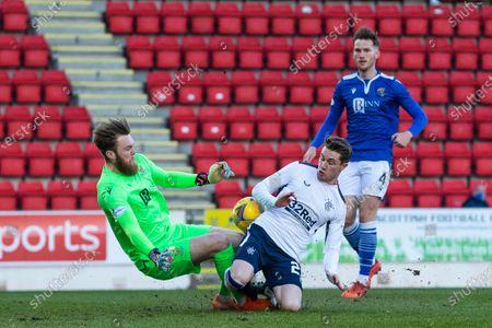 Scott Wright of Rangers challenges St Johnstone goalkeeper Zander Clark during the Scottish Premiership match at McDiarmid Park, Perth.