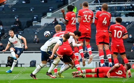 Tottenham's Eric Dier (L) takes a free-kick during the English Premier League soccer match between Tottenham Hotspur and Southampton FC in London, Britain, 21 April 2021.