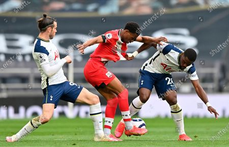 Southampton's Nathan Tella (C) is sandwiched between Tottenham's Gareth Bale (L) and Tottenham's Serge Aurier (R) during the English Premier League soccer match between Tottenham Hotspur and Southampton FC in London, Britain, 21 April 2021.