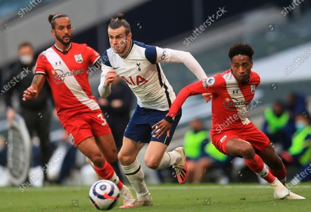 Stock Image of Tottenham's Gareth Bale (C) in action with Southampton's Theo Walcott (L) during the English Premier League soccer match between Tottenham Hotspur and Southampton FC in London, Britain, 21 April 2021.
