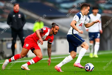 Tottenham's Sergio Reguilon (R) in action with Southampton's Theo Walcott (L) during the English Premier League soccer match between Tottenham Hotspur and Southampton FC in London, Britain, 21 April 2021.