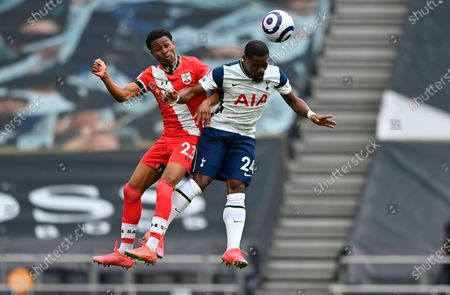 Tottenham's Serge Aurier (R) in action with Southampton's Nathan Tella (L) during the English Premier League soccer match between Tottenham Hotspur and Southampton FC in London, Britain, 21 April 2021.