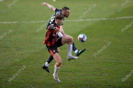 Scott Malone of Millwall clashes with David Brooks of Bournemouth during the Millwall vs AFC Bournemouth, EFL Championship Football match at the New Den London held behind closed doors.