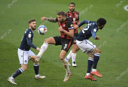 Steve Cook of Bournemouth defends a Millwall attack during the Millwall vs AFC Bournemouth, EFL Championship Football match at the New Den London held behind closed doors.