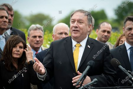 Former US Secretary of State Mike Pompeo, offers remarks while joined by members of the Republican Study Committee to introduce their Maximum Pressure Act against Iran, outside of the US Capitol in Washington, DC,.