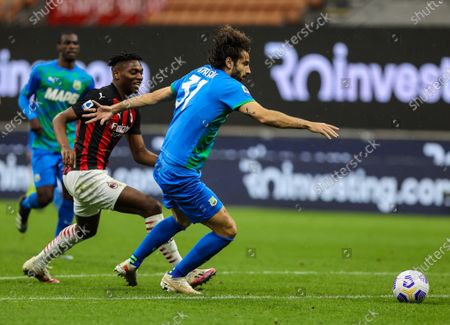 Rafael Leao of AC Milan fights for the ball against Gian Marco Ferrari of US Sassuolo