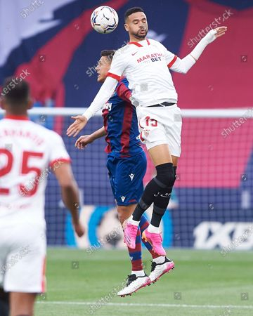 Youssef En-Nesyri of Sevilla and Oscar Duarte of Levante UD during the La Liga match between Levante UD and Sevilla at Estadio Ciutat de Valencia on 21 April, 2021 in Valencia, Spain
