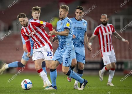 Nick Powell of Stoke City is tackled by Kyle McFadzean of Coventry City; Bet365 Stadium, Stoke, Staffordshire, England; English Football League Championship Football, Stoke City versus Coventry.
