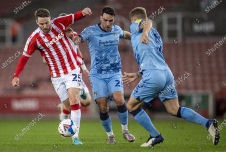 Nick Powell of Stoke City is tackled by Matty James of Coventry City; Bet365 Stadium, Stoke, Staffordshire, England; English Football League Championship Football, Stoke City versus Coventry.