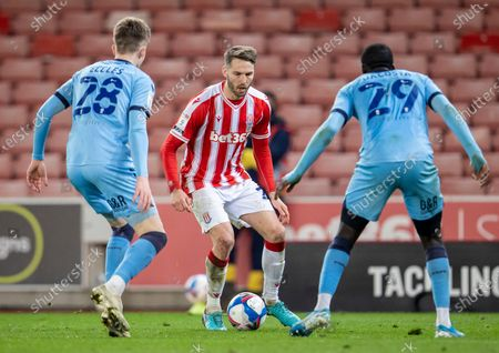 Nick Powell of Stoke City under pressure from Julien Dacosta and Josh Eccles of Coventry City; Bet365 Stadium, Stoke, Staffordshire, England; English Football League Championship Football, Stoke City versus Coventry.
