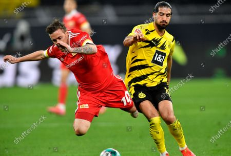 Union's Max Kruse, left, and Dortmund's Emre Can challenge for the ball during the German Bundesliga soccer match between Borussia Dortmund and Union Berlin in Dortmund, Germany