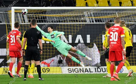 Dortmund's goalkeeper Marwin Hitz jumps for the ball after a free kick by Union's Max Kruse during the German Bundesliga soccer match between Borussia Dortmund and Union Berlin in Dortmund, Germany