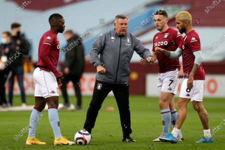 Aston Villa's assistant coach Craig Shakespeare talks to the players during warmup before the English Premier League soccer match between Aston Villa and Manchester City at Villa Park Stadium in Birmingham, England