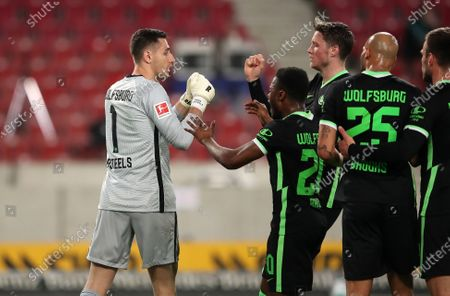 Koen Casteels of VfL Wolfsburg interacts with Ridle Baku after making a save from a penalty during the German Bundesliga soccer match between VfB Stuttgart and VfL Wolfsburg at Mercedes-Benz Arena in Stuttgart, Germany, 21 April 2021.